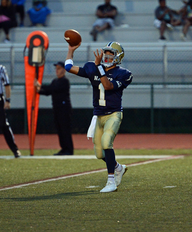 . CR South quarterback Christian Jabbar (1) completes outlet pass.