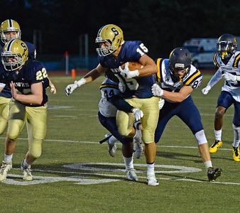 Nick Gallo (15) is brought down by Cory Biddle (44) and Mike Enfinger (83).
