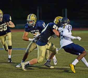 Nick Gallo (15) follows block by Jake Diaz (29).