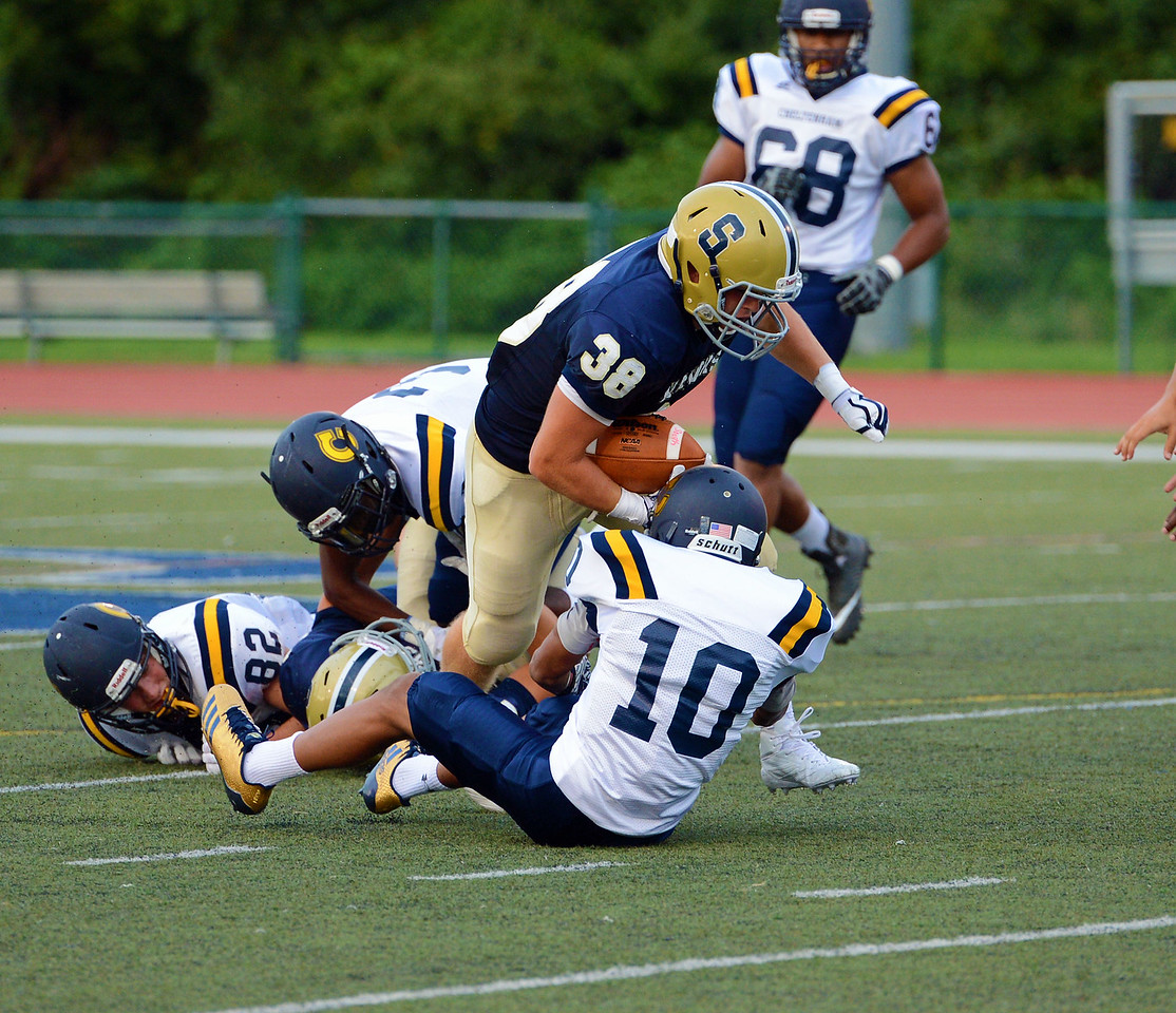 Sam Vaniver (38) runs over Donovan Stevenson (10).