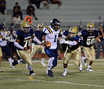 Bradley Kraut (7) and Shamir Parker (76) run down Jordan Gyabaah (1).
