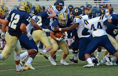 Sam Vaniver (38) picks up tough yards.