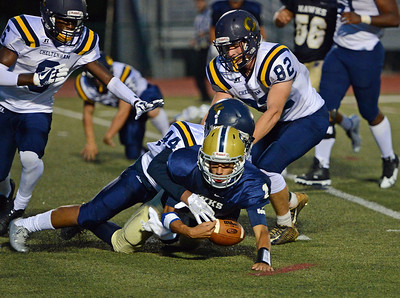 Christian Jabbar (1) is tackled by Ceeon Whitehead (44).