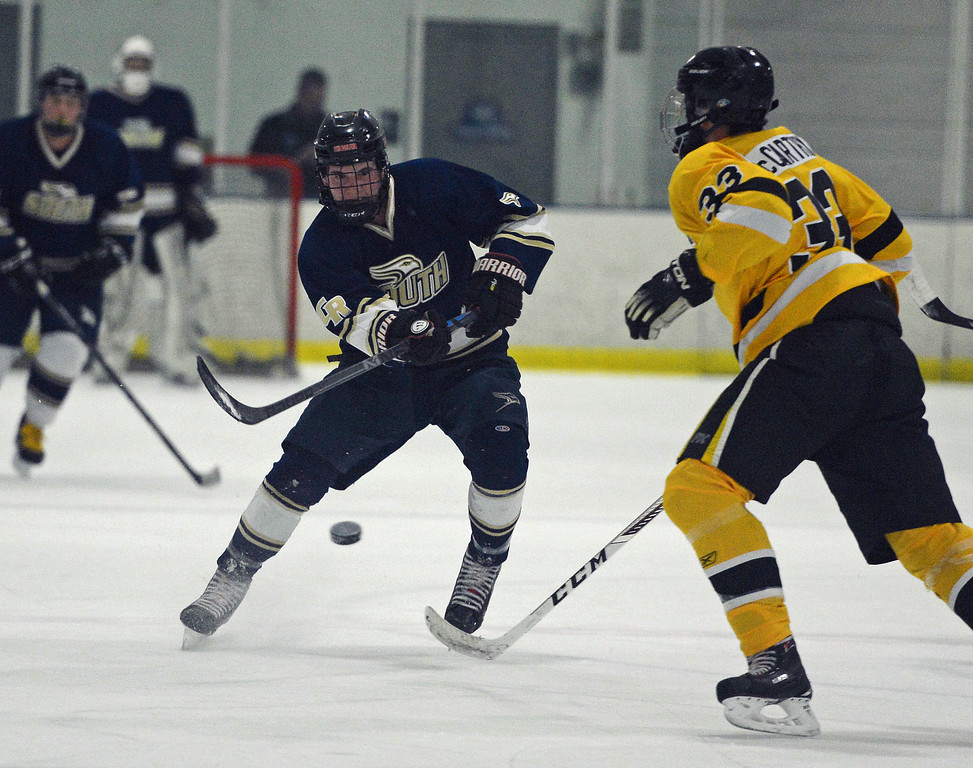 . Logan Hurwitz lifts puck by CB West defender.