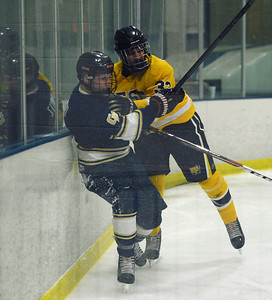 Andy Stoychev is slammed into the boards by Matt McCarthy.