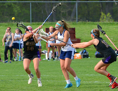 Caroline McGovern (5) scores despite tough Upper Moreland defense.
