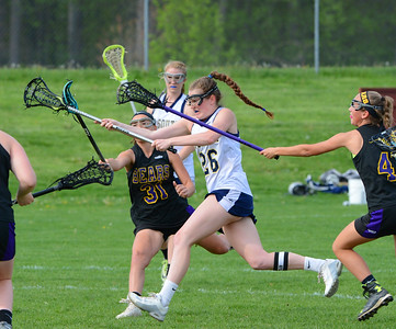 Mary Kate Simpson (26) scores for the Golden Hawks.