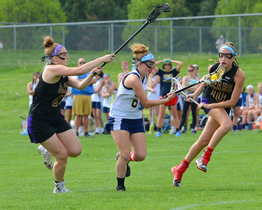 Sarah Womer (6) splits Upper Moreland defenders.