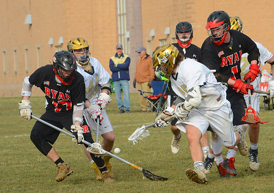 Brett Randby (23) fights for a ground ball.