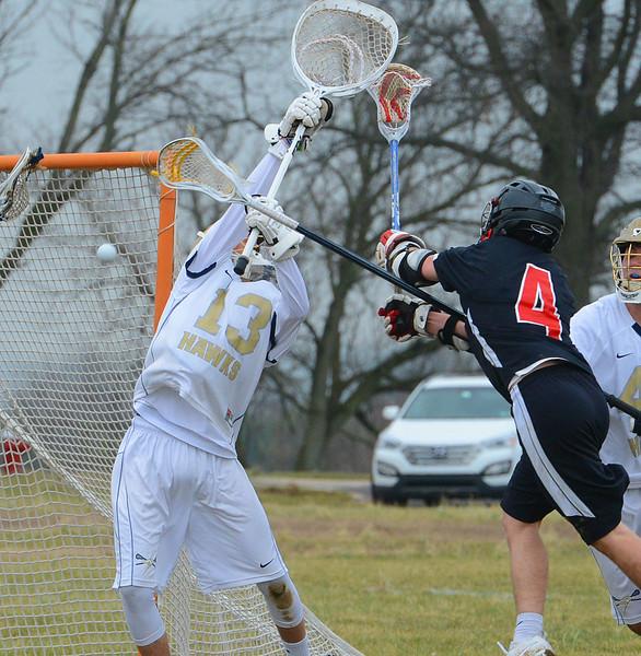Dan Schlupp (13) tries to deflect shot on goal.