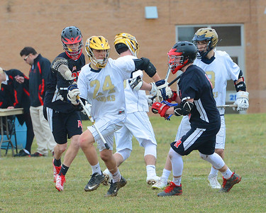 Phil Mignacca (24) breaks free from Ryan defenders.