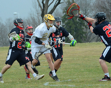 Phil Mignacca (24) pressures Archbishop Ryan goalie.