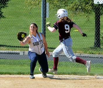 Lauren Kropp (15) nips Abington runner at first base.