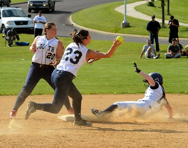 PhyliciaWilkov (23) fires to first as Marissa Haynes (11) slides in safely.