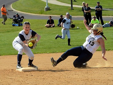 Madison Tomlinson (9) gets force on Melanie Wilkinson (13).