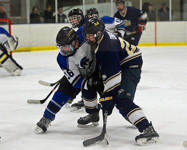 Matt Owens (23) and Nick Morelli (36) fight for position.