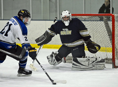 Mason Procz (30) gets set to block Colin Abbonizio's (21) shot.