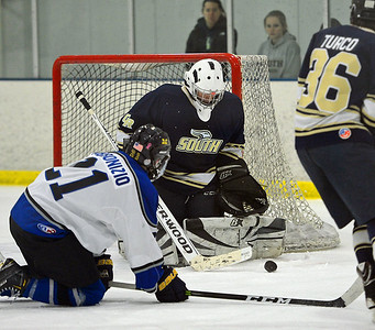 Mason Procz (20) makes pad save.