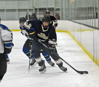 Matt Owens (23) maneuvers puck through CB South's defense.