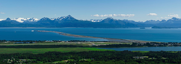 Panorama of Homer.  The spit is surrounded by Kachemak Bay with mountains in the Kachemak Bay State Park and Wilderness in the background.