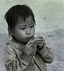 Boy Eating a Dead Bird, Khong Toune, Laos