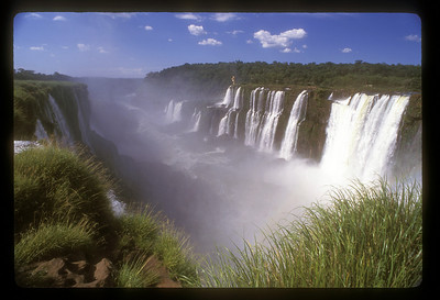Long view of waterfall, Iguazu Falls National Park, Argentina.