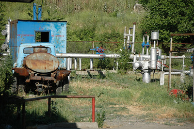 Pipes near fuel station, rural Armenia.