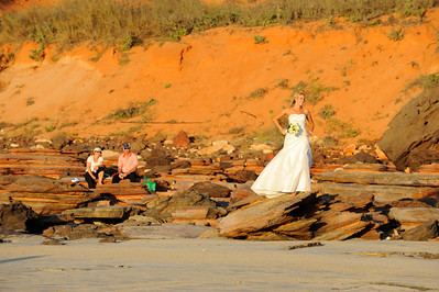 Bride on Cable Beach, with spectators, Broome, Australia.