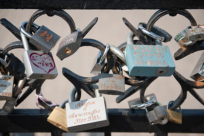 Lovers put locks with their names on bridges and throw the key in the river in Minsk, Belarus.