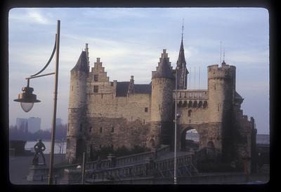 Het Steen, or Steen Castle, and Lange Wapper statue, Antwerp, Belgium.