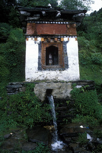 Prayer wheel turned by stream, Bhutan.