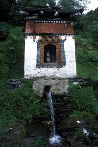 Prayer wheel turned by stream, Bhutan.