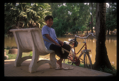 Boy on the banks of the Siem Reap River, Siem Reap, Cambodia.
