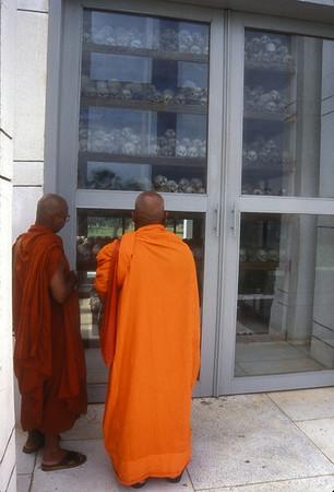 Monks at Genocide Museum, Phnom Penh, Cambodia.
