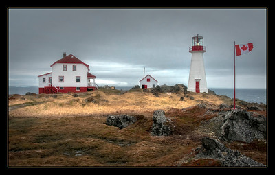 This is the Cape Bauld lighthouse on Quirpon Island, about a six kilometer long island off the northern tip if Newfoundland, Canada. The view is to the north, across the Belle Isle Strait, and straight across is the southern shore of Labrador, just beyond the iceberg there on the left.