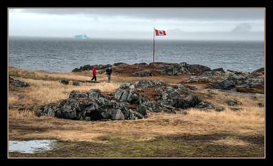 Quirpon Island, Newfoundland, Canada, with iceberg.