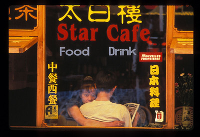 Young couple in Star Cafe, Foreigner's Street in Dali, China.