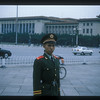 Policeman and the Great Hall of the People, the Chinese legislature, Beijing, China.