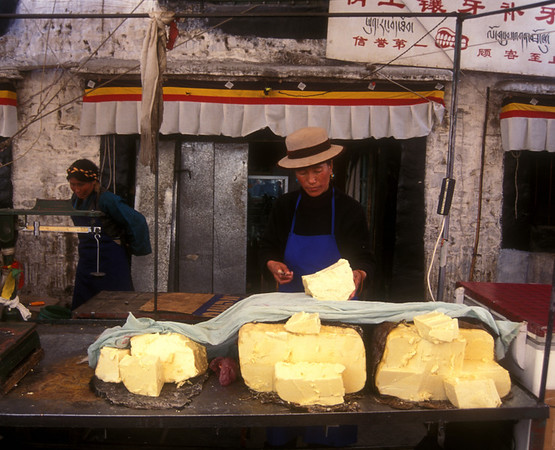 This lady is selling yak cheese on Barkhor Street around Jokhang Temple, Lhasa, Tibet.