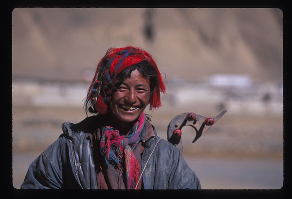 Tibetan nomad, with home made musical instrument.