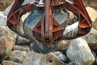 Moving rocks in Victoria harbor, Hong Kong, China.
