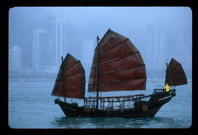 Junk in the rain, Hong Kong's Victoria Harbor, China.