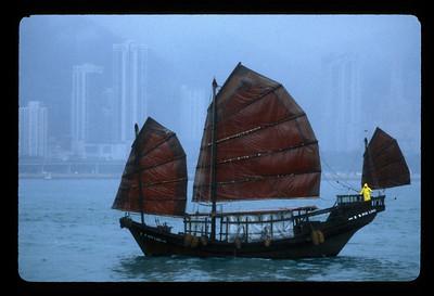 Junk in the rain, Hong Kong's Victoria Harbor, China.