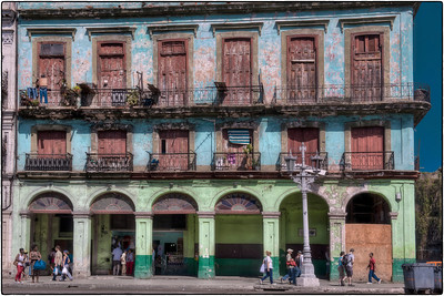 The building in this photo is directly across the street from the Capitol building in Havana, Cuba. The revolutionary government abolished the Congress in 1959, and now the Capitol building is home to the Cuban Academy of Sciences.