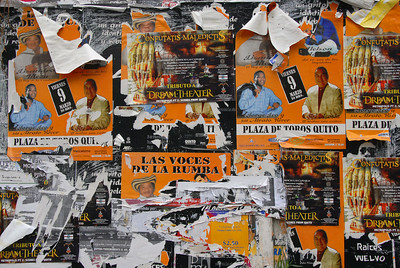 Ads on the wall, downtown Quito, Ecuador.
