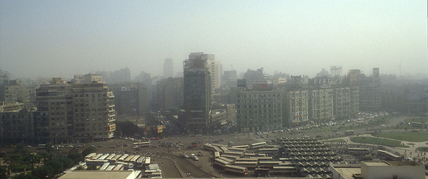 Cairo, Egypt bus station and skyline.