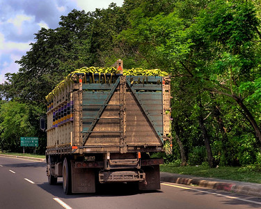 HDR: The first transport truck across the border in El Salvador. Banana Republic?