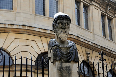 Statue with a snowy hat, Oxford, England.