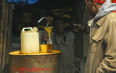 Petrol salesboy, Addis Ababa, Ethiopia.