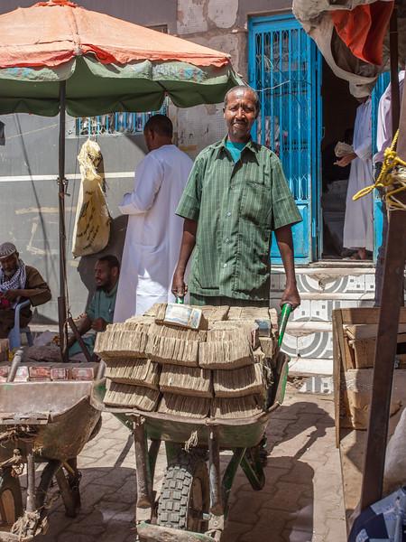 Carying money in wheelbarrow